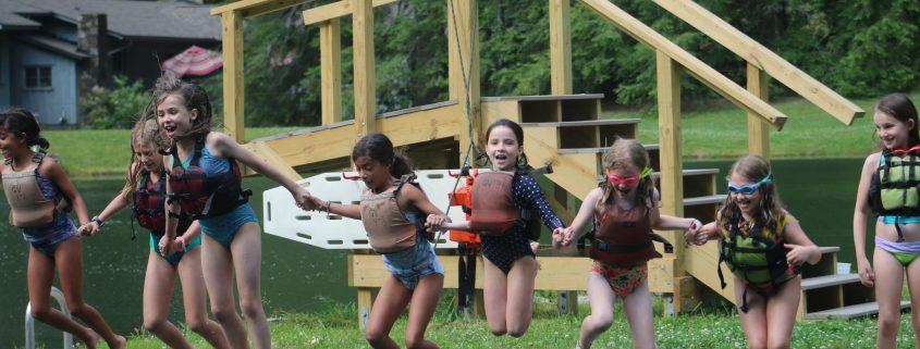 Girls Jumping in Lake